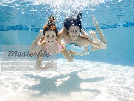 USA, Utah, Orem, Portrait of young women under water