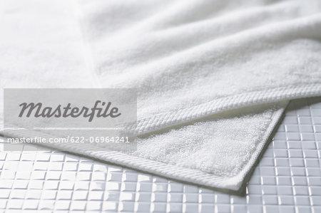 White towels on tiled floor