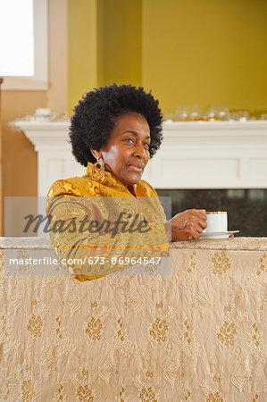 Portrait of elegant woman in gold jacket