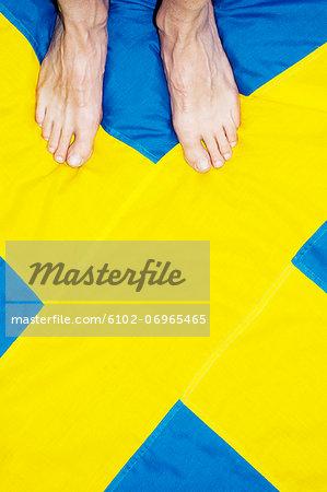 High angle view of bare feet