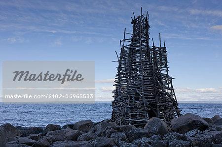 "Wooden construction ""Nimis"" on rocky beach"