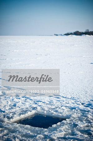Hole in frozen sea