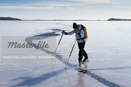 Person skating at frozen sea