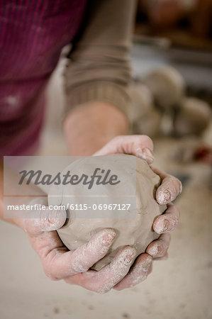 Craftswoman kneading clay ball, Bavaria, Germany, Europe
