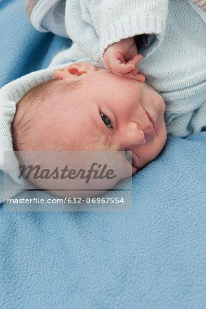 Baby boy lying on blanket
