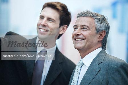 Business partners smiling outdoors, portrait