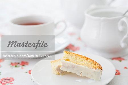 Lemon Biscotti with Cup of Tea and Sugar Bowl, Studio Shot