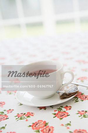 Cup of Tea with Used Tea Bag on Table, Studio Shot