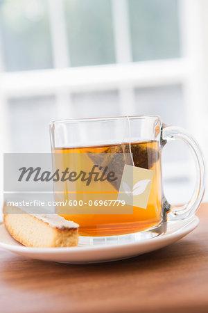 Cup of Tea in Clear Mug with Lemon Biscotti, Studio Shot