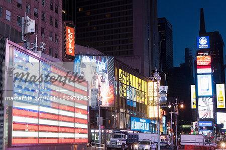 Illuminated billboards at night, New York, USA