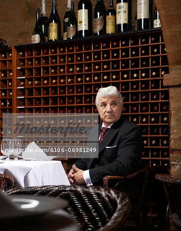 Senior man sitting at table in restaurant
