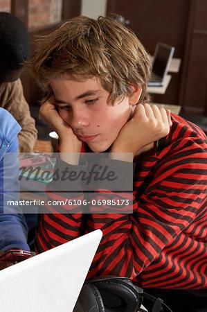Teenage boy (14-17) looking at laptop, close-up