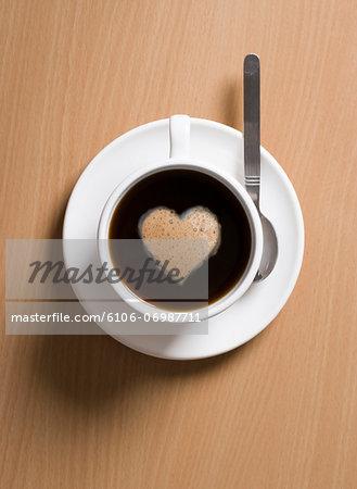 Coffee with heart shape in foam