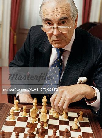 Senior Businessman Playing Chess