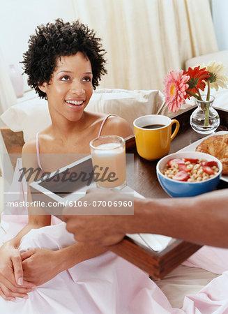 Man Giving His Partner Breakfast in Bed