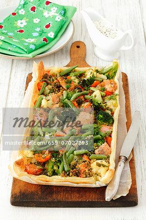 A cauliflower, broccoli, carrot and salmon tart