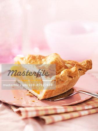 A slice of peach pie