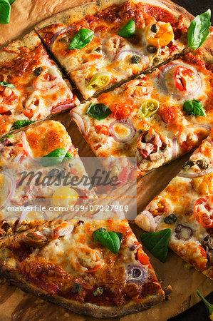 Sliced Onion, Pepper and Tomato Pizza on a Pizza Board