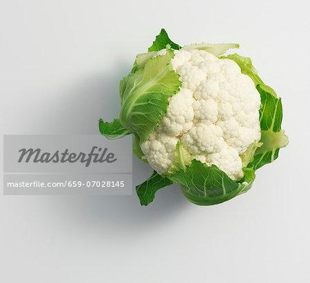 A cauliflower on a white surface