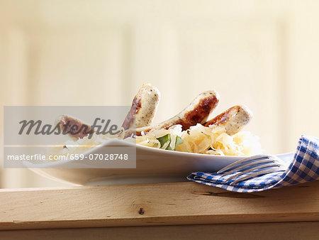 Oven-roasted sausages on sauerkraut
