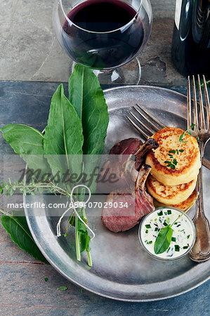 Lamb chops with potato pancakes and sorrel sauce