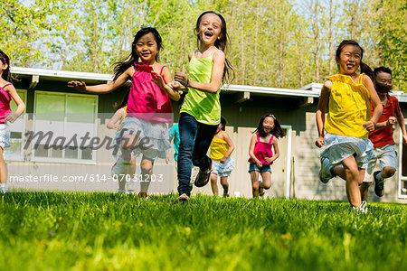 Children running on grass