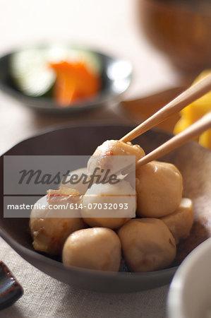 Still life of chopsticks picking up japanese dumpling