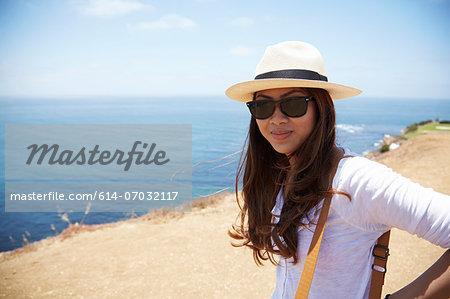 Young woman wearing sunhat at coast Palos Verdes, California, USA