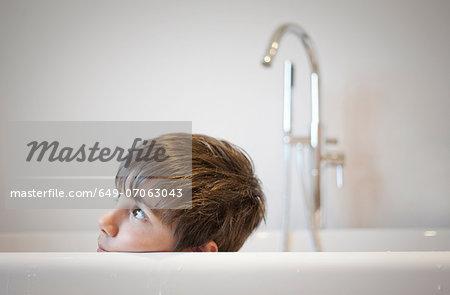 Head shot of young boy in bath