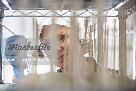 Chocolatier inspecting chocolate in sweet factory