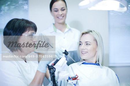 Dentist preparing to treat patient