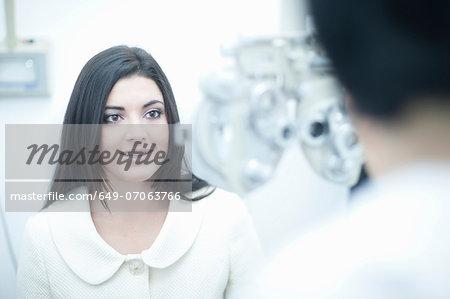 Young woman at opticians