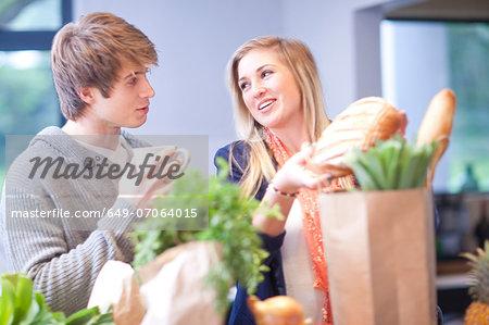 Young woman unpacking shopping