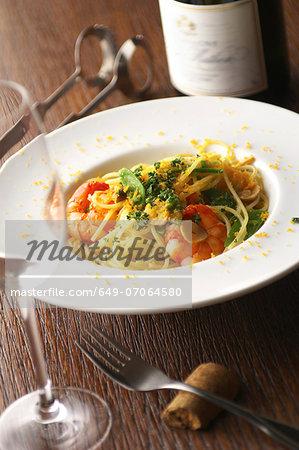 Still life of spaghetti with prawns and garnish