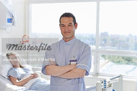 Portrait of nurse standing in front of patient