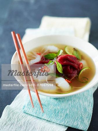 Bowl of Rare Beef Pho (Pho Tai) with Chopsticks, Studio Shot