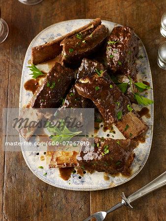 Overhead View of Beef Ribs on Platter, Studio Shot