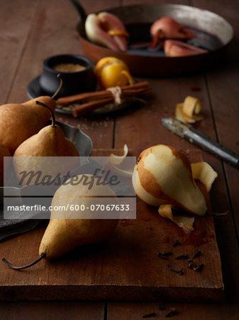 Peeling Bosc Pears on Cutting Board, Studio Shot
