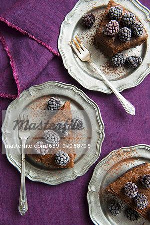 Chocolate cake with frozen blackberries