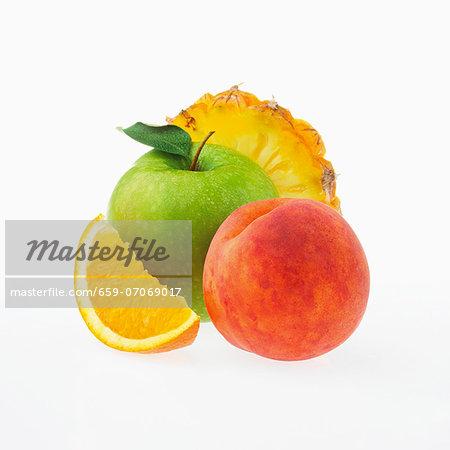 Apple, peach, orange and pineapple