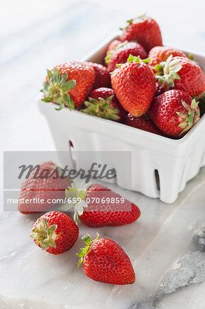 Fresh strawberries in a porcelain basket