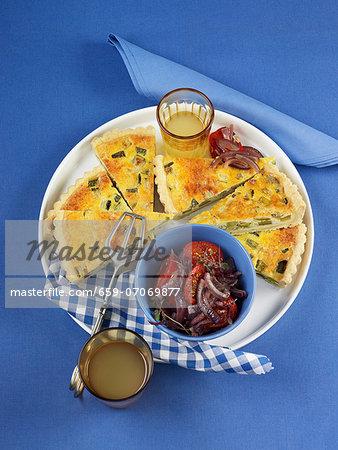 Courgette quiche with tomato and onion salad