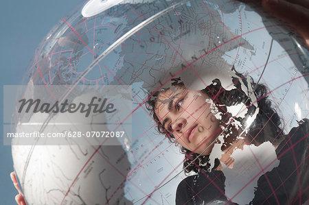Girl holding transparent globe outdoors
