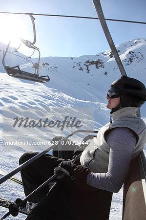 Man in chair lift, Hochfuegen, Zillertal, Tyrol, Austria