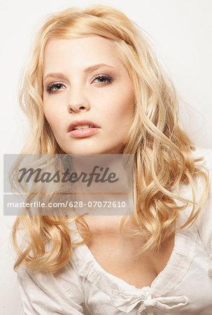 Blond woman wearing white top