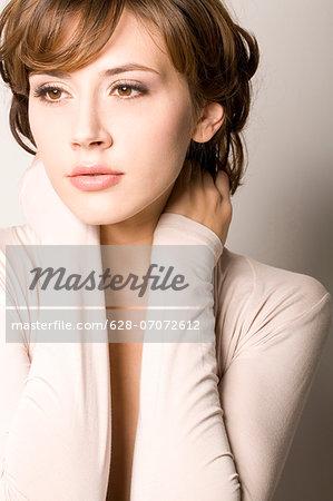 Brunette woman wearing beige top