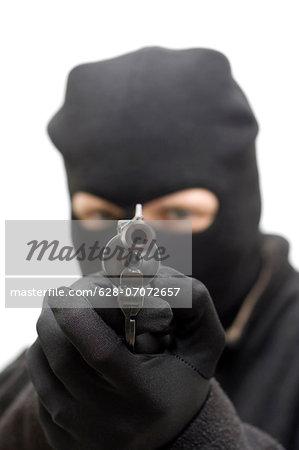 Criminal aiming a hand gun