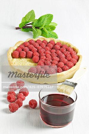 Preparing a raspberry tart