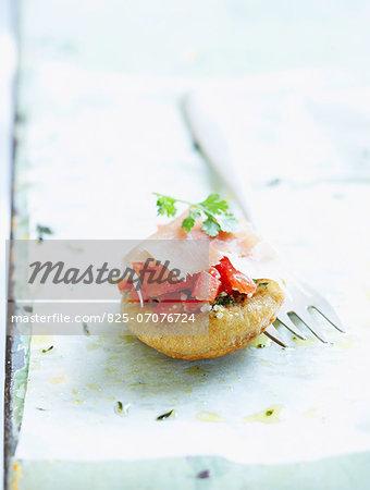 Tomato and raw ham bite-size appetizer