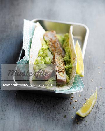 Pan-fried tuna and guacamole wrap